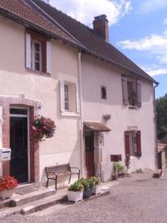 In front of the cottage is a quiet courtyard and it is well away from the road, behind the church..