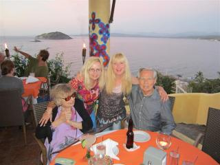 Einem family dining on cliff with spectacular views of the area.