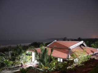 VILLA AT NIGHT WITH SEA IN THE BACKGROUND