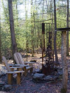 A private sculptural steel fireplace just outside the cabin