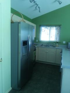 The kitchen is small and convenient with new stainless steel appliances and a water filter.