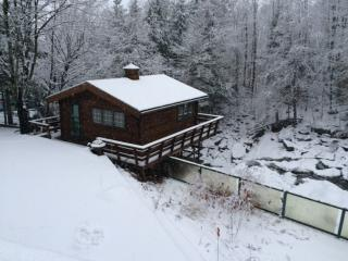 cottage above waterfall - winter view