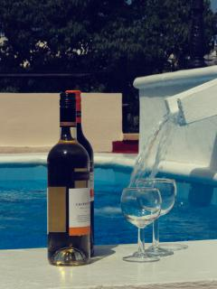 Stop dreaming! Book now and within a few months time you'll be drink wine aswell by the pool.