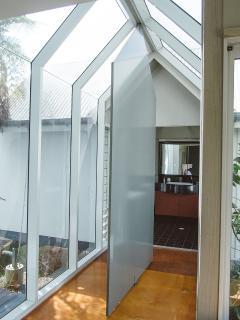 Through glass walkway to Maste en suite
