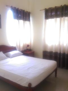 Double bedroom with large double bed and double wardrobe.  Equipped with air con and fan.