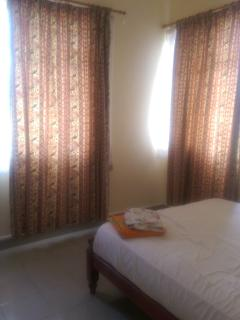 Double bedroom with double bed and double wardrobe,  Equipped with aircon and fan