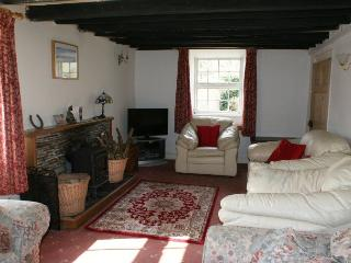 The lounge comprises of 3 two seater sofas, 2 armchairs, a log burner & an electric storage heater
