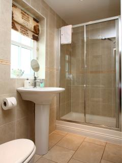 Large en-suite with generous sized shower cubicle, power shower and luxurious white towels