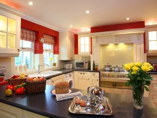 The open plan kitchen is fully equipped including range style cooker,dishwasher and washer-dryer