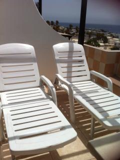 sunbeds on balcony