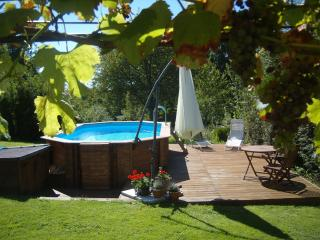 Sunny pool terrace with sunbeds & parasol