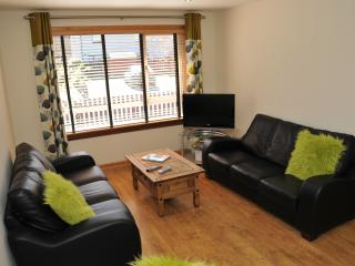 Spacious lounge with TV, DVD/CD player