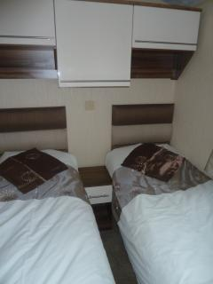 Twin bedroom with television and dvd player