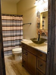 2nd bathroom w/ granite counters and pedestal sink