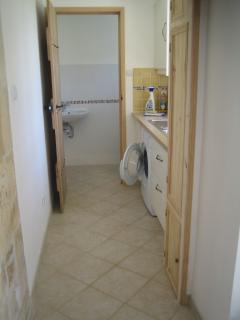 The Cottage - utility with washing machine and extra downstairs toilet (for garden and bbq! )beyond