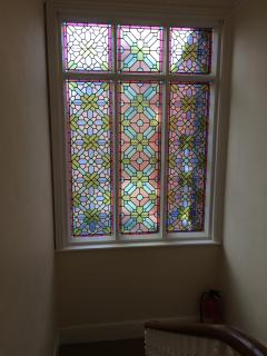 Stained glass window to the stairs