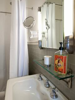 Original art deco medicine cabinet and vintage pedestal sink.