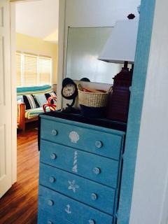 Nautical themed bedroom with trundle bed and loft