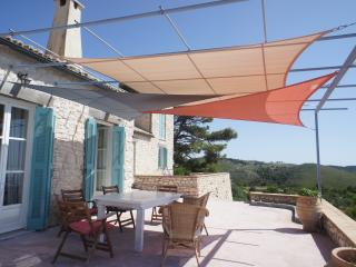 Soak up the view and watch the sunset under the shade sails