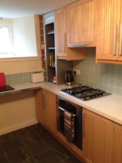 Kitchen showing electric oven and gas hob
