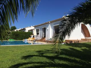 rear view of the villa and pool from the garden