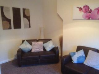 the lounge area with 2 double leather sofas, 32' tv, and views to the front/sea