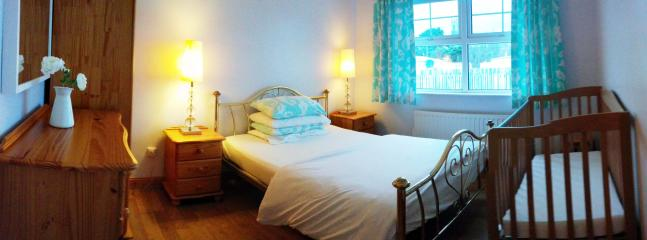 One of the back bedrooms where the wooden cot is located on this occasion.