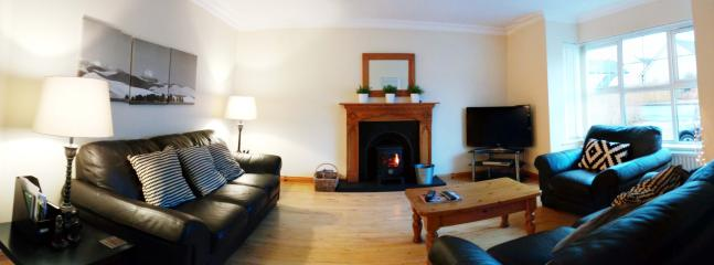 The livingroom containing a 42' TV, DVD player, Italian leather suite, woodburning stove etc.