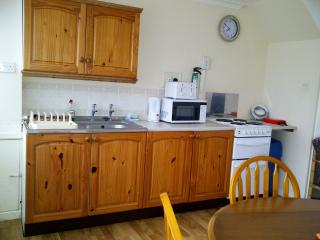 Well equipped kitchen complete with fridge freezer, electric cooker and microwave