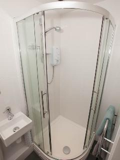 The en suite shower room with heated towel rail.