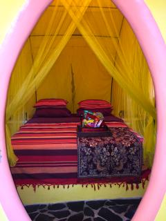 Queen size bed with canopy.