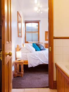 Double bedroom with en-suite bath/over bath shower toilet situated on the lower ground floor
