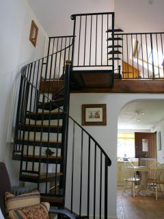 Spiral staircase leading to the bedroom area