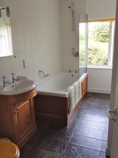 Neates House bathroom, shower over bath, basin and toilet