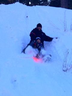 Sledding right behind the cabin!