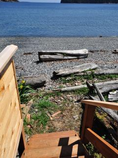 Your private access to Departure Bay Beach is via stairs from your cedar deck.