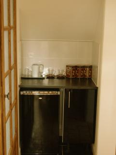 Kitchenette with fridge plates and cutlery