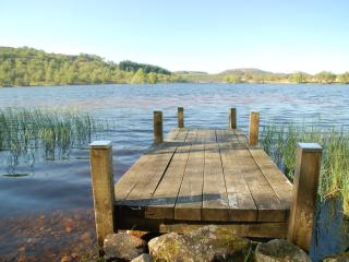A private jetty with access to Loch Knockie from our cottage.