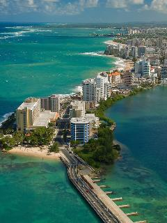 aerial of Condado neighborhood, the apt is on the far end facing ocean (on the left of the picture)