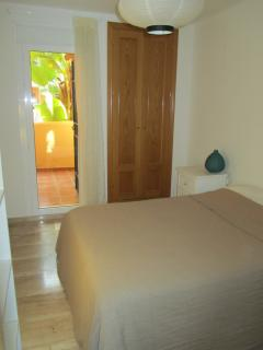 The bedroom leads to the terrace and offer ample storage space for clothes and holiday essentials