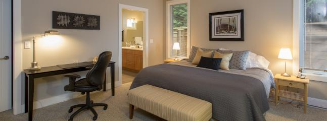 The main floor master bedroom has a king bed, large walk-in closet, huge private ensuite bathroom
