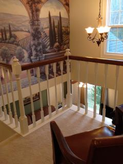 Looking out from the upstairs landing to the living room below.