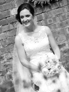 Beautiful bride in the courtyard garden of the River House