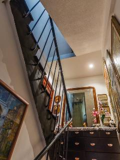 Interior stairs in the French townhouse to Casa Carlotta on the second floor