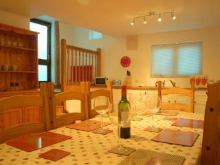 Spacious kitchen dining room, with two utility rooms.