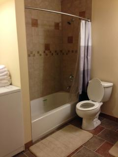 Tub/shower combination and radiant heat flooring