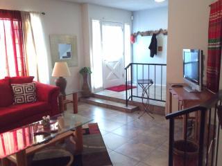 Living room with flat screen tv, front door entrance