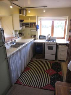 Fully Equipped Kitchen with coffee maker, microwave, blender, toaster oven, propane range