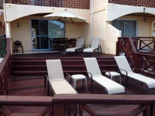 Large Deck with 5 loungers, dining for 6 with BBQ, solar light parasol