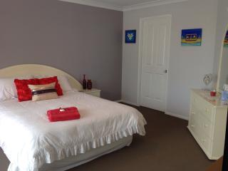 Queen bedroom with balcony and ensuite upstairs